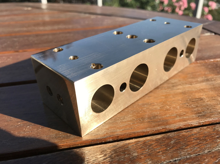 Cylinder block for a 2 cylinder steam engine made in a lathe.