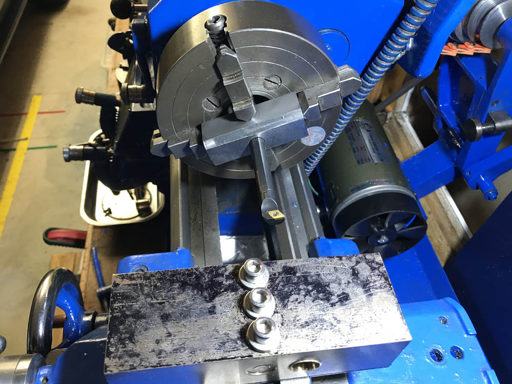 A photos of the boring bar holder in the 4 jaw chuck for boring cylinders